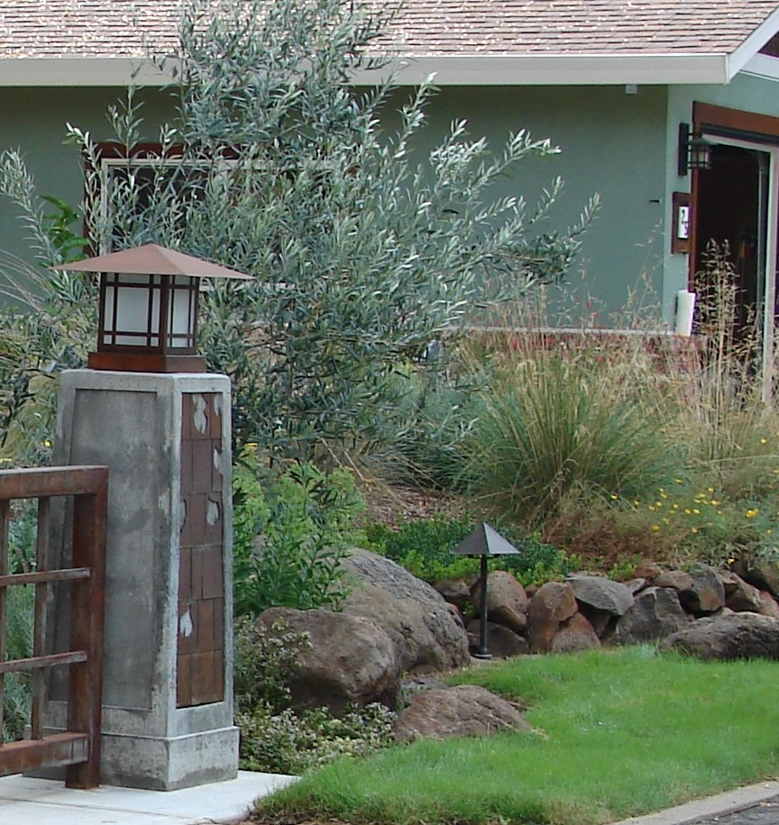 native no-mow lawn, boulders, and stone walls