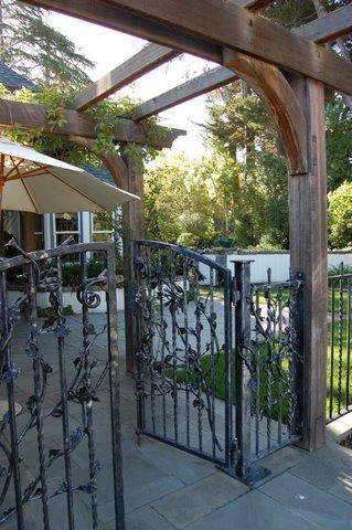 Iron gate with redwood pergola