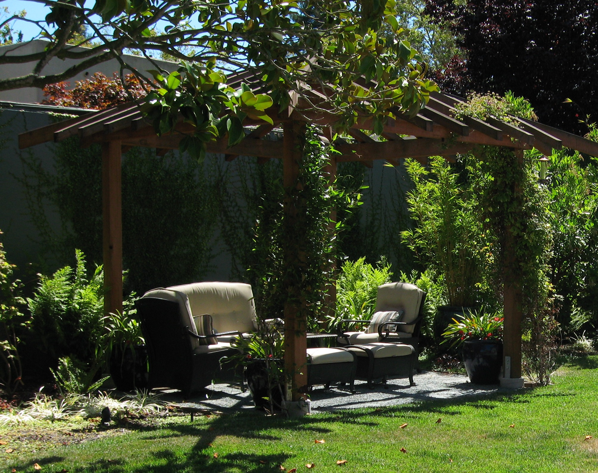seating area shaded with a custom pergola